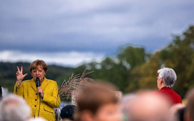 German Chancellor Angela Merkel gives a speech at a harvest festival as she tours the city of Lauterbach on the Baltic Island of Ruegen, northeastern Germany, on September 23, 2017. (AFP/dpa/Jens Büttner)
