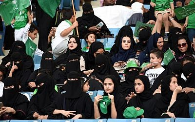 Saudi women sit in a stadium to attend an event in the capital Riyadh on September 23, 2017 commemorating the anniversary of the founding of the kingdom. (AFP PHOTO / Fayez Nureldine)