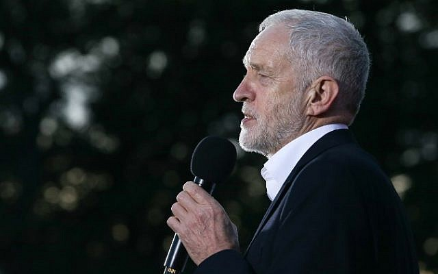Illustrative: Britain's opposition Labour party's leader Jeremy Corbyn delivers a speech at a rally on the eve of Labour Conference in Brighton, September 23, 2017. (AFP/Daniel LEAL-OLIVAS)