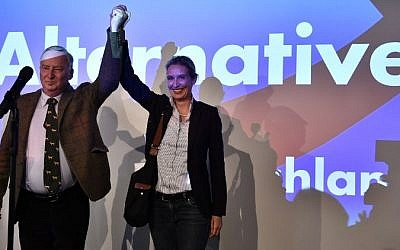 Top candidates of the Alternative for Germany (AfD) Alexander Gauland, left, and Alice Weidel celebrate on stage during an election night event in Berlin during the general election on September 24, 2017.  (AFP/ John MACDOUGALL)