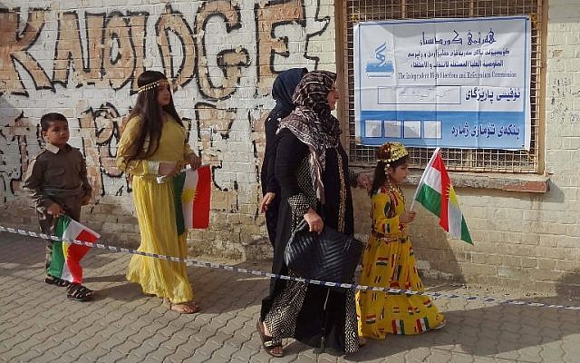 Iraqi Kurds arrive at a polling station to cast their votes in the Kurdish independence referendum in the city of Kirkuk in northern Iraq, on September 25, 2017. (AFP Photo/Marwan Ibrahim)