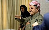Iraqi Kurdish leader Massoud Barzani arrives to cast his vote in the Kurdish independence referendum at a polling station near Irbil, on September 25, 2017. (AFP Photo/Ahmed Deeb)