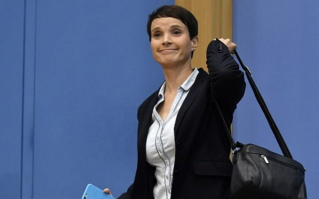 AfD co-leader Frauke Petry leaves a press conference for the nationalist party on September 25, 2017, in Berlin, where she said she refused to join the AfD parliamentary group. (AFP Photo/John Macdougall)