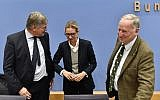 (L-R) Leadership members of the hard-right party AfD (Alternative für Deutschland) Joerg Meuthen, Alice Weidel and Alexander Gauland leave after addressing a press conference on the day after the German General elections on September 25, 2017 in Berlin. (AFP PHOTO / John MACDOUGALL)