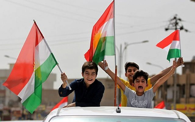 Iraqis Kurds celebrate with the Kurdish flag in the streets of the northern city of Kirkuk on September 25, 2017, as they vote in a referendum on independence. (AFP PHOTO/ AHMAD AL-RUBAYE)