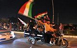 Iraqi Kurds wave the Kurdish flag as they celebrate in the streets of the northern city of Kirkuk on September 25, 2017 following a referendum on independence. (AFP PHOTO/AHMAD AL-RUBAYE)