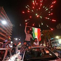 Iraqi Kurds wave the Kurdish flag as they celebrate in the streets of the northern city of Irbil on September 25, 2017, following a referendum on independence. (AFP PHOTO / Safin HAMED)