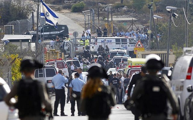Emergency services respond to a terror attack outside the Har Adar settlement near Jerusalem, in which three were killed and one wounded, on September 26, 2017. (Menahem Kahana/AFP PHOTO)