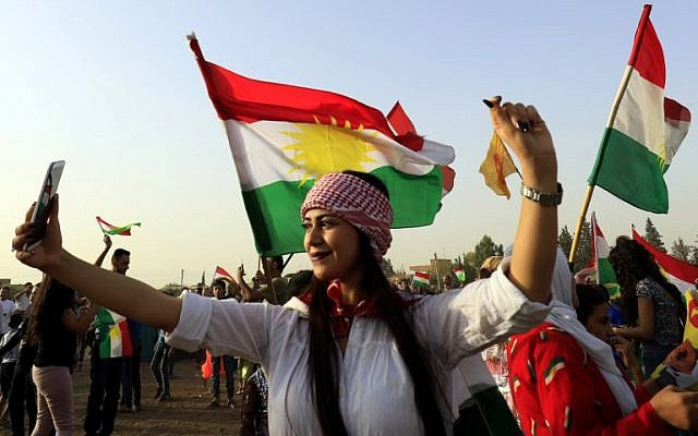 A Syrian Kurd takes a selfie, in the northeastern Syrian city of Qamishli on September 26, 2017, during a gathering in support of the independence referendum in Iraq's autonomous northern Kurdish region. ( AFP/ Delil souleiman)