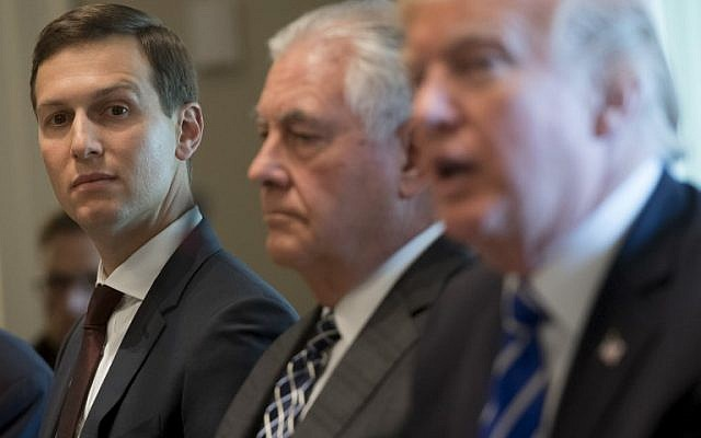 US President Donald Trump sits alongside US Secretary of State Rex Tillerson, middle, and Senior Adviser Jared Kushner, left, in the Cabinet Room of the White House in Washington, DC, September 26, 2017. (AFP PHOTO / SAUL LOEB)