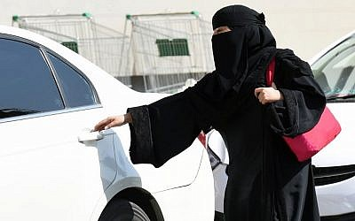 This file photo taken on October 26, 2014, shows a Saudi woman getting into a taxi at a mall in Riyadh. (AFP Photo/Fayez Nureldine)