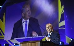 Prime Minister Benjamin Netanyahu gives a speech during a celebration of the 50 years of Jewish settlement in the West Bank and Golan Heights, at commemoration event in the Gush Etzion settlement bloc on September 27, 2017.  (AFP PHOTO / MENAHEM KAHANA)
