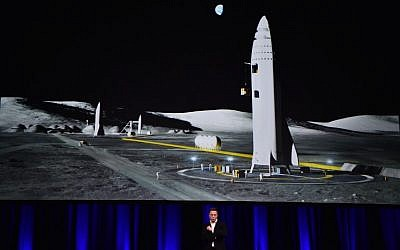 Billionaire entrepreneur and founder of SpaceX Elon Musk speaks below a computer generated illustration of his new rocket at the 68th International Astronautical Congress 2017 in Adelaide on September 29, 2017.   (AFP PHOTO / PETER PARKS)