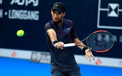Dudi Sela of Israel hits a return against Alexandr Dolgopolov of Ukraine during their men's singles quarter-final match at the ATP Shenzhen Open tennis tournament in Shenzhen, southern China's Guangdong province on September 29, 2017. (AFP/STR)