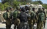 IDF soldiers impose a closure on the Palestinian village of Bayt Surik after a resident carried out a terror attack at a nearby Israeli settlement in which three people were killed on September 26, 2017. (Israel Defense Forces)