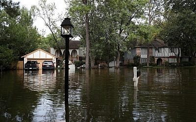Homes surrounded by floodwaters September 3, 2017, in Houston, Texas. (Justin Sullivan/Getty Images/AFP)
