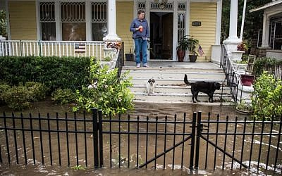 A man looks out over storm surge flood waters from Hurricane Irma along the St. Johns River on September 11, 2017 in Jacksonville, Florida. (Sean Rayford/Getty Images/AFP)
