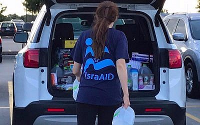 IsraAID team member organizes relief supplies for Hurricane Harvey victims in shelters in Dallas, Texas, August 29, 2017 (IsraAID)