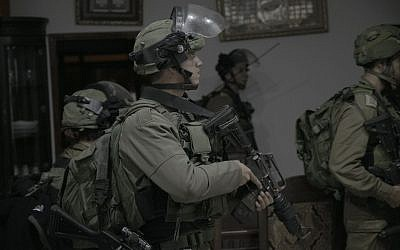 Israeli security forces carry out raids in the West Bank on September 27, 2017, following the terror attack in the settlement of Har Adar the day before. (IDF Spokesperson)