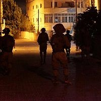 Illustrative: IDF soldiers conduct raids in the West Bank on September 28, 2017. (Israel Defense Forces)