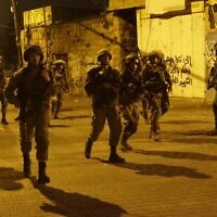Illustrative: IDF troops during a raid in the West Bank. (Israel Defense Forces)