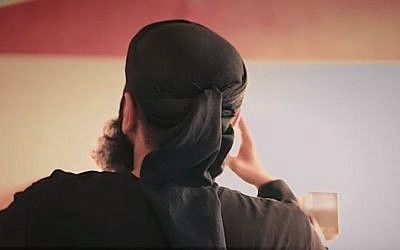 Notorious hate preacher Abu Walaa showing his back in an online video, as has become his trademark. (Screen capture: YouTube)