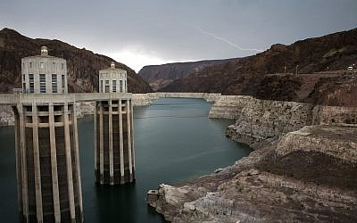 Lightning strikes over Lake Mead near Hoover Dam at the Lake Mead National Recreation Area in Arizona, July 28, 2014. (AP Photo/John Locher, File)