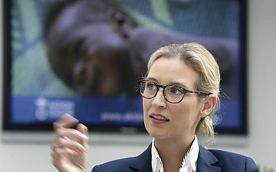 Alice Weidel of the German AfD (Alternative for Germany) party, sits in front of a news screen as she awaits a press conference in Berlin, Germany, August 21, 2017. (AP/Michael Sohn)