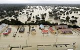Water from Addicks Reservoir flows into neighborhoods as floodwaters from Tropical Storm Harvey rise in Houston, Texas, August 29, 2017. (AP/David J. Phillip)