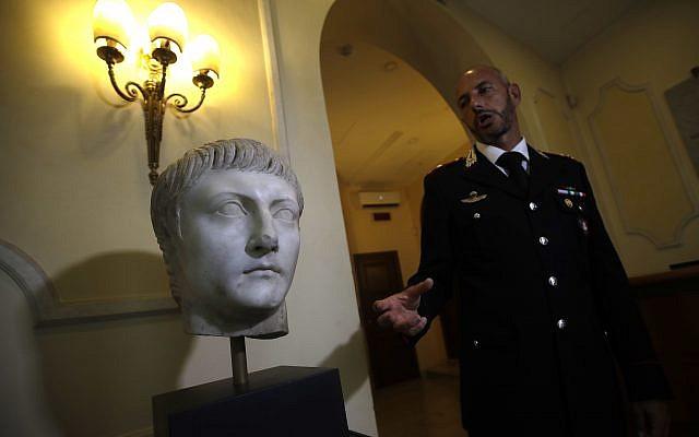 Italian Carabinieri officer Massimo Maresca shows the first century AC Druso marble head during an interview in the Carabinieri barracks, Friday, September 1, 2017 (AP/Alessandra Tarantino)