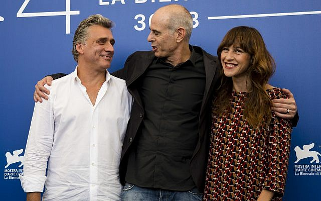 """Director Samuel Maoz, center, and actors Lior Ashkenazi, left, and Sarah Adler pose during the photo call for the film """"Foxtrot"""" at the 74th Venice Film Festival in Venice, Italy, Saturday, Sept. 2, 2017. (AP Photo/Domenico Stinellis)"""