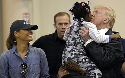 President Donald Trump and Melania Trump meet people impacted by Hurricane Harvey during a visit to the NRG Center in Houston, Saturday, Sept. 2, 2017. (AP/Susan Walsh)