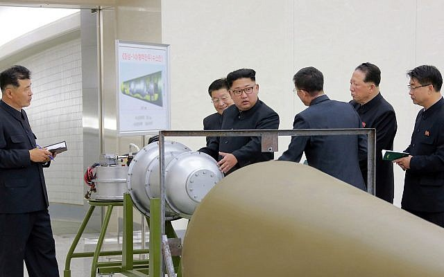 In this undated image distributed on Sunday, September 3, 2017, by the North Korean government, shows North Korean leader Kim Jong Un at an undisclosed location. North Korea's state media on Sunday, Sept 3, 2017, said Kim inspected the loading of a hydrogen bomb into a new intercontinental ballistic missile (Korean Central News Agency/Korea News Service via AP)