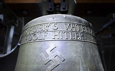 In this May 19, 2017 photo a church bell with the inscription 'Everything for the fatherland Adolf Hitler' and a swastika is pictured in the town church in Herxheim am Berg, western Germany. (Uwe Anspach/dpa via AP, file)