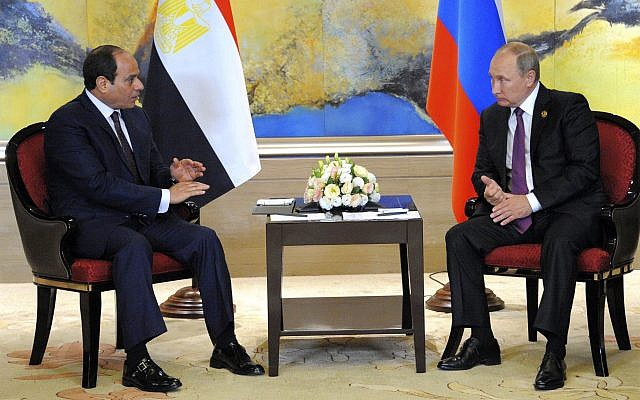 Russian President Vladimir Putin, right, and Egyptian President Abdel-Fattah el-Sissi hold a  bilateral meeting on the sidelines of the BRICS Summit in Xiamen, Fujian province, China, Monday, Sept. 4, 2017.(MENA via AP)