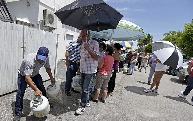 Residents stand in line to purchase propane gas as they prepare for Hurricane Irma, September 5, 2017, in Hialeah, Florida. (AP Photo/Alan Diaz)