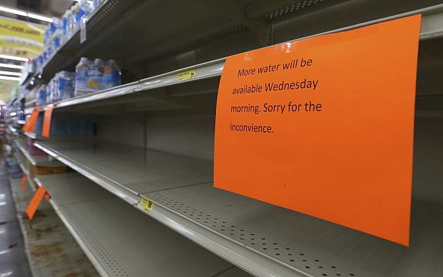 A shelf normally containing packaged water is empty at a Piggly Wiggly store Tueday, September 5, 2017, in Panama City, Florida. (Patti Blake/News Herald via AP)