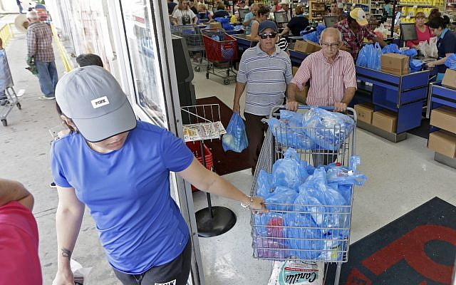 Customers purchase groceries at a local supermarket as they prepare for Hurricane Irma, September 5, 2017, in Hialeah, Florida. (AP Photo/Alan Diaz)