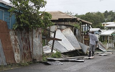 A man surveys the wreckage on his property after the passing of Hurricane Irma, in St. John's, Antigua and Barbuda, Wednesday, Sept. 6, 2017.  (AP/Johnny Jno-Baptiste)