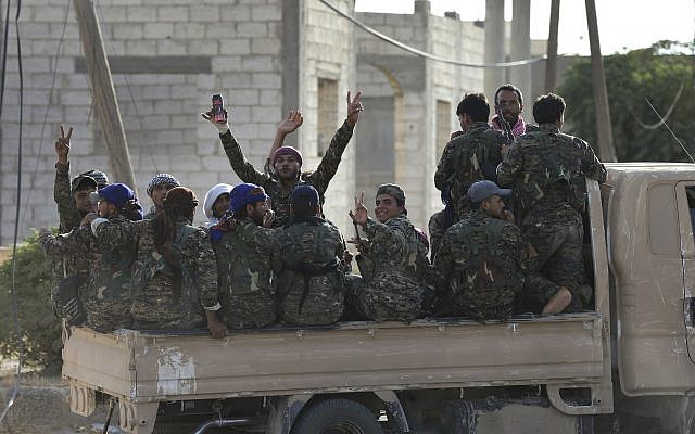 File: Arab and Kurdish fighters with the US-backed Syrian Democratic Forces move toward the front line to battle against the Islamic State militants, in Raqqa, northeast Syria, July 22, 2017. (AP/Hussein Malla, File)