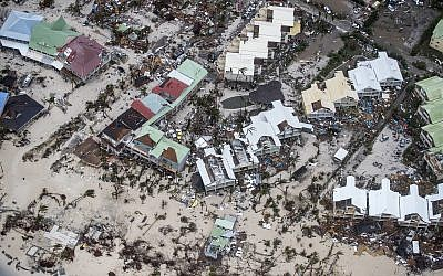 This Sept. 6, 2017 photo provided by the Dutch Defense Ministry shows storm damage in the aftermath of Hurricane Irma, in St. Maarten. (Gerben Van Es/Dutch Defense Ministry via AP)