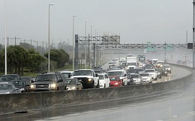 Northbound traffic on the turnpike near Sunrise Blvd. is backed up  in the rain as motorist prepare for Hurricane Irma on Thursday, Sept. 7, 2017 in Sunrise, Fla. (Mike Stocker/South Florida Sun-Sentinel via AP)