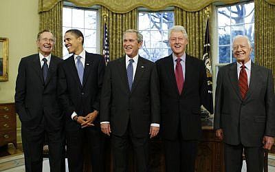 In this January 7, 2009, photo, then-President-elect Barack Obama is welcomed by then-President George W. Bush for a meeting at the White House in Washington, Wednesday, Jan. 7, 2009, with former presidents, from left, George H.W. Bush, Bill Clinton and Jimmy Carter. (AP Photo/J. Scott Applewhite, File)
