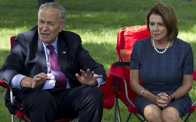 Senate Minority Leader Chuck Schumer of NY, left, and House Minority Leader Nancy Pelosi of California speak on Capitol Hill in Washington, September 7, 2017 (AP/Jose Luis Magana)