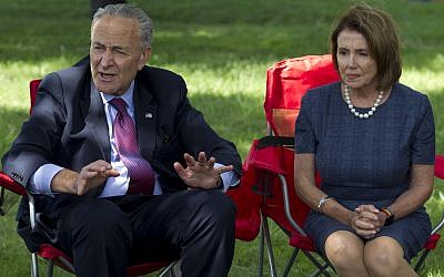 Senate Minority Leader Chuck Schumer of NY, accompanied by House Minority Leader Nancy Pelosi of California speak on Capitol Hill in Washington, September 7, 2017. (AP/Jose Luis Magana)
