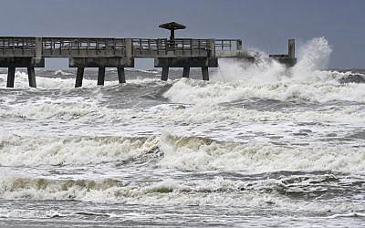 Waves crash on the Jacksonville Beach Fishing Pier in  Jacksonville Beach, Florida, as Hurricane Irma approaches Florida on September 9, 2017. (Bob Mack/The Florida Times-Union via AP)
