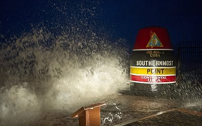 As Hurricane Irma swirled toward Florida, waves crash against the southernmost point in Key West, Florida, September 9, 2017.  (Rob O'Neal/The Key West Citizen via AP)
