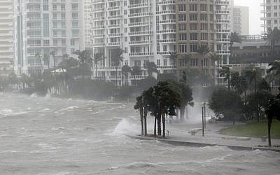 Waves crash over a seawall at the mouth of the Miami River from Biscayne Bay, Florida., as Hurricane Irma passes by, Sempember 10, 2017, in Miami. (AP Photo/Wilfredo Lee)