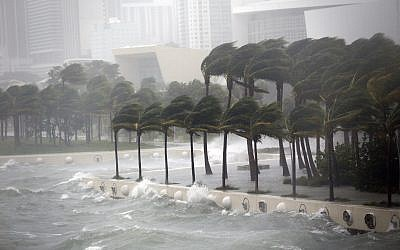 Waves crash over a seawall from Biscayne Bay as Hurricane Irma passes by, Sunday, Sept. 10, 2017, in Miami. (AP/Wilfredo Lee)