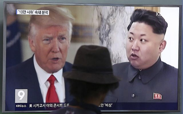 A man watches a television screen showing US President Donald Trump and North Korean leader Kim Jong Un during a news program at the Seoul Train Station in Seoul, South Korea, August 10, 2017. (AP Photo/Ahn Young-joon, File)